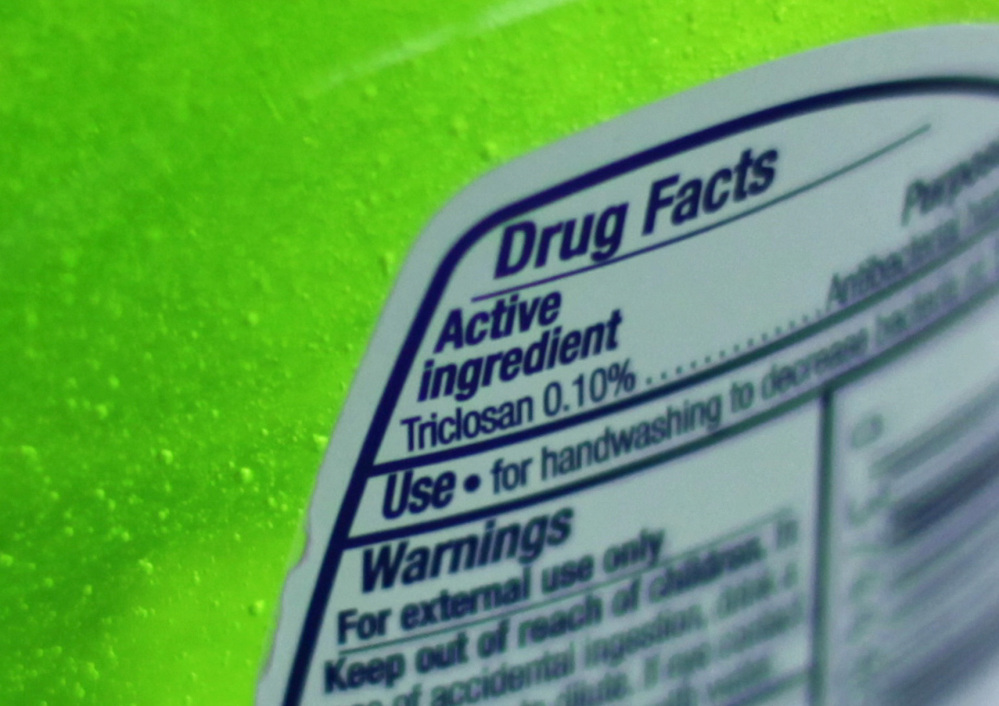 This Tuesday, April 30, 2013 file photo shows the label of a bottle of antibacterial soap in a kitchen in Chicago. The U.S. government is banning more than a dozen chemicals, including triclosan, long-used in antibacterial soaps and washes, saying manufacturers have failed to show that they are safe and prevent the spread of germs.