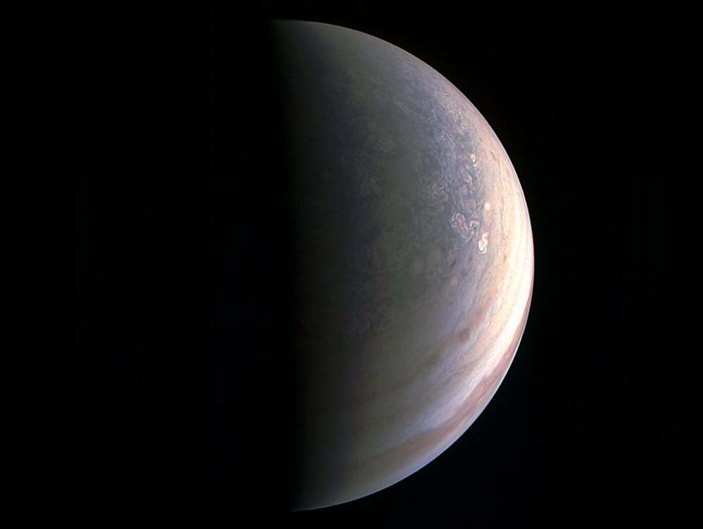 Image provided by NASA shows Jupiter's north polar region as photographed by the Juno spacecraft.