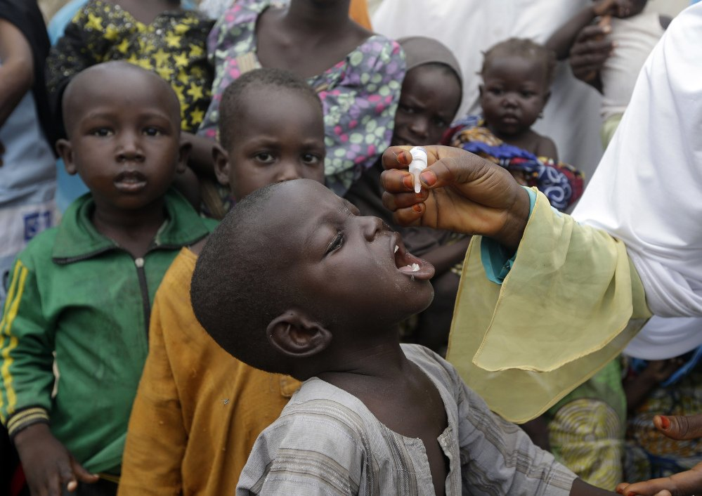 Polio vaccine is administered at a camp for people displaced by Islamist extremists in Maiduguri, Nigeria. A campaign aims to vaccinate 25 million children this year.