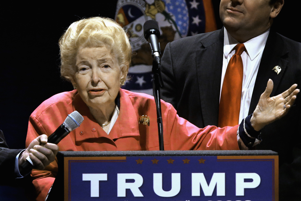 Phyllis Schlafly endorses Republican presidential candidate Donald Trump on March 11 before Trump begins speaking at a campaign rally in St. Louis. Schlafly, who founded the Eagle Forum political group, died Monday at the age of 92.