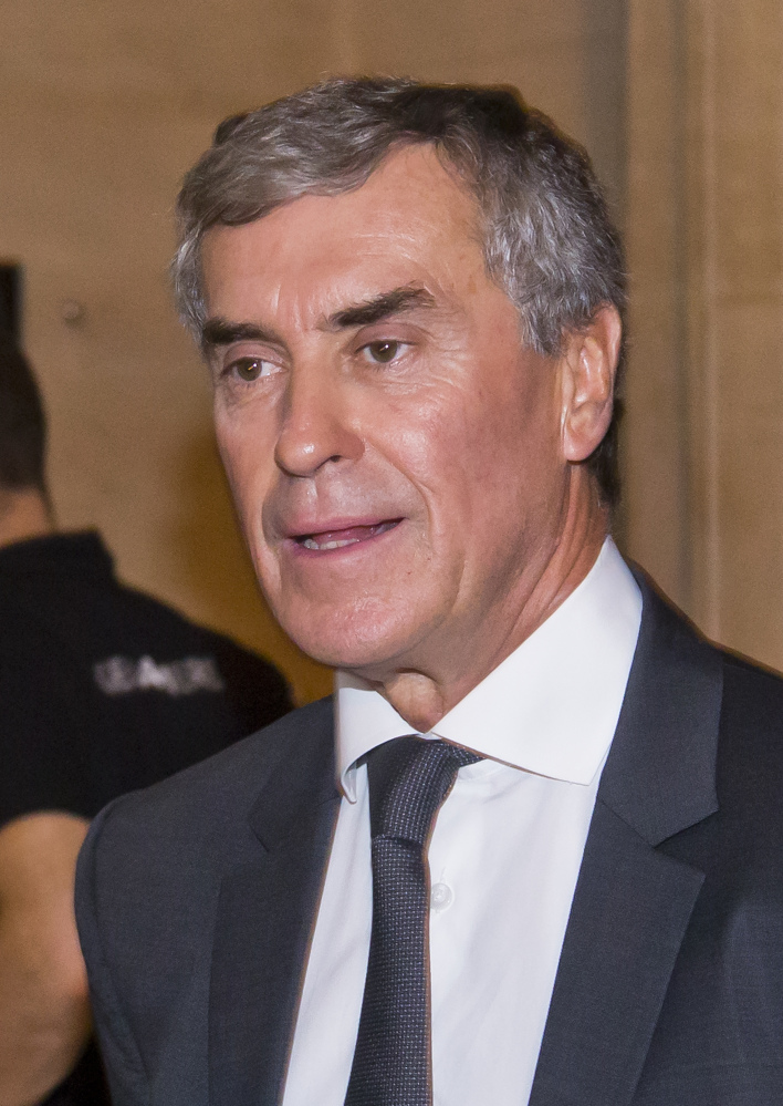 Former French budget Minister Jerome Cahuzac leaves Paris' courthouse , Monday, Sept. 5, 2016. A former French budget minister goes on trial for hiding part of his wealth in tax havens around the world while fighting tax evasion at home. (AP Photo/Michel Euler)