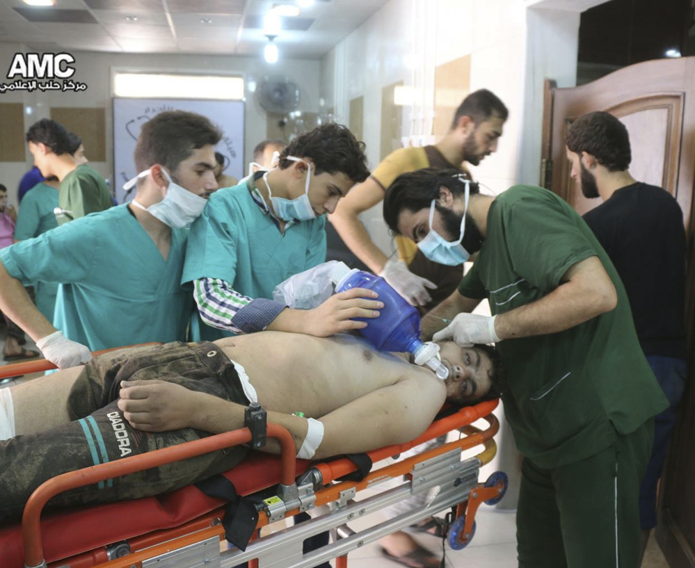 A man is treated for breathing difficulties in a hospital in Aleppo after a suspected chlorine gas attack Tuesday. The same area of Aleppo was hit by an airstrike Wednesday.