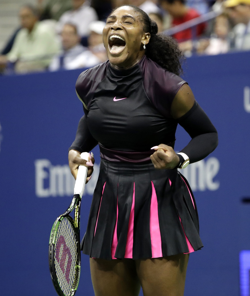 Serena Williams celebrates Wednesday night after winning a game against Simona Halep during the U.S. Open quarterfinals in New York. Williams, seeking a record 23rd major championship, will take on 10th-seeded Karolina Pliskova next.