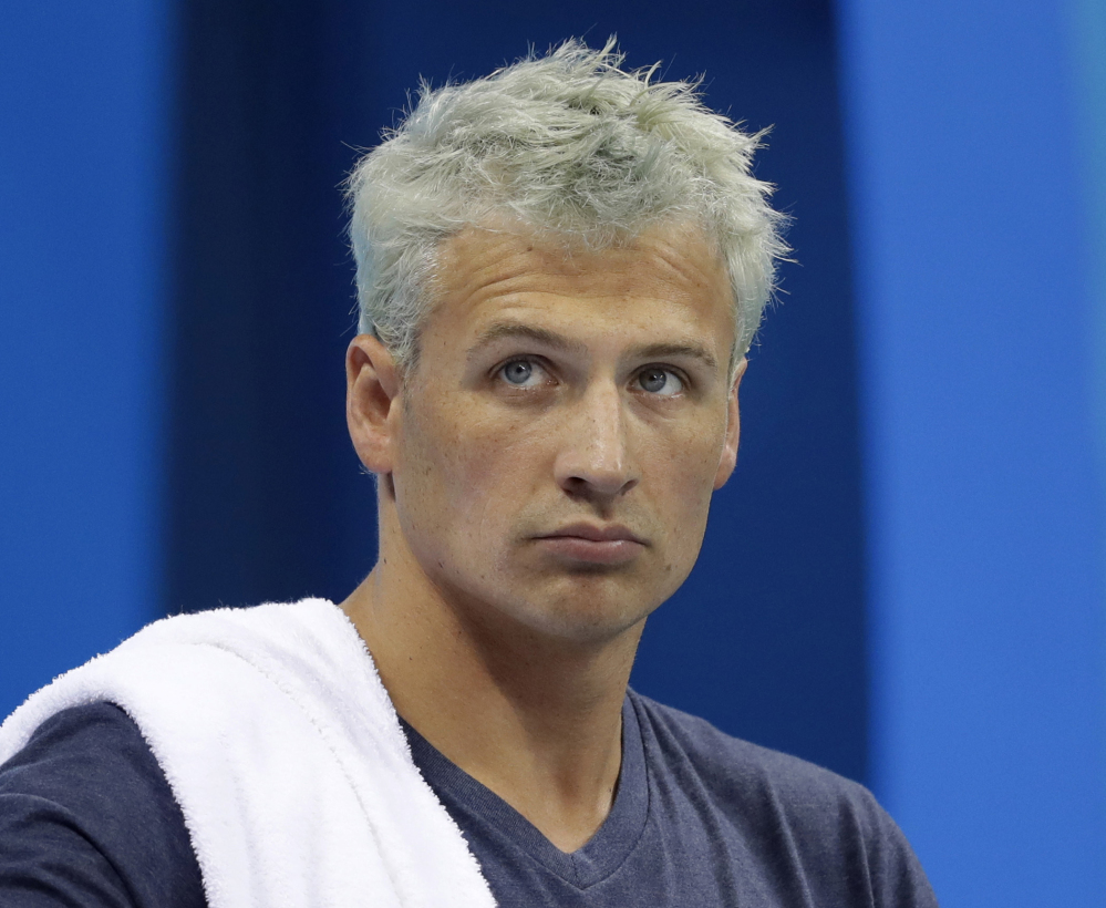 Associated Press/Michael Sohn, File Ryan Lochte prepares before a men's 4x200-meter freestyle heat at the 2016 Summer Olympics, in Rio de Janeiro, Brazil. Lochte is banned from swimming through next June and will forfeit $100,000 in bonus money that went with his gold medal at the Olympics, part of the penalty for his drunken encounter at a gas station in Brazil during last month's games.