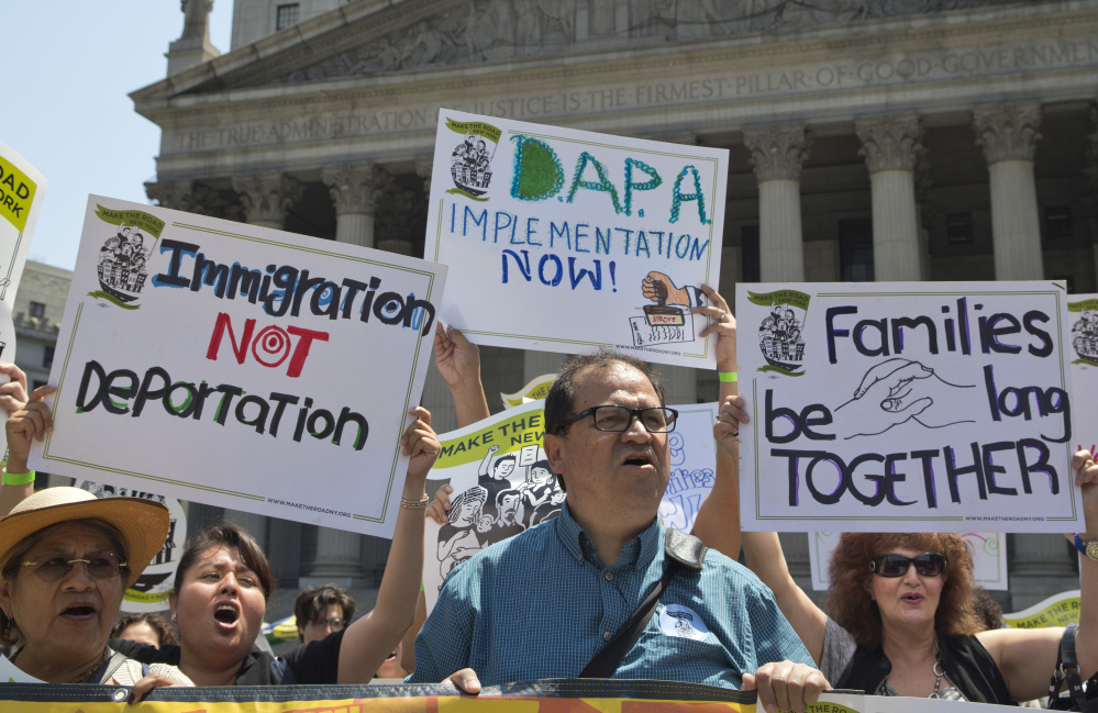 Demonstrators gather outside the New York Supreme Court in June to protest against a U.S. Supreme Court decision on immigration.