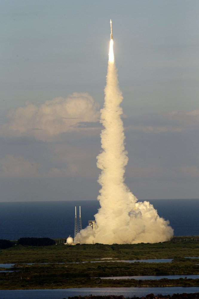 A United Launch Alliance Atlas V rocket carrying the Origins, Spectral Interpretation, Resource Identification, Security-Regolith Explorer (OSIRIS-REx) spacecraft lifts off from launch complex 41 at the Cape Canaveral Air Force Station, Thursday, Sept. 8, 2016, in Cape Canaveral, Fla. Osiris-Rex will travel to asteroid Bennu, collect ground samples, then haul them back to Earth. (AP Photo/John Raoux)