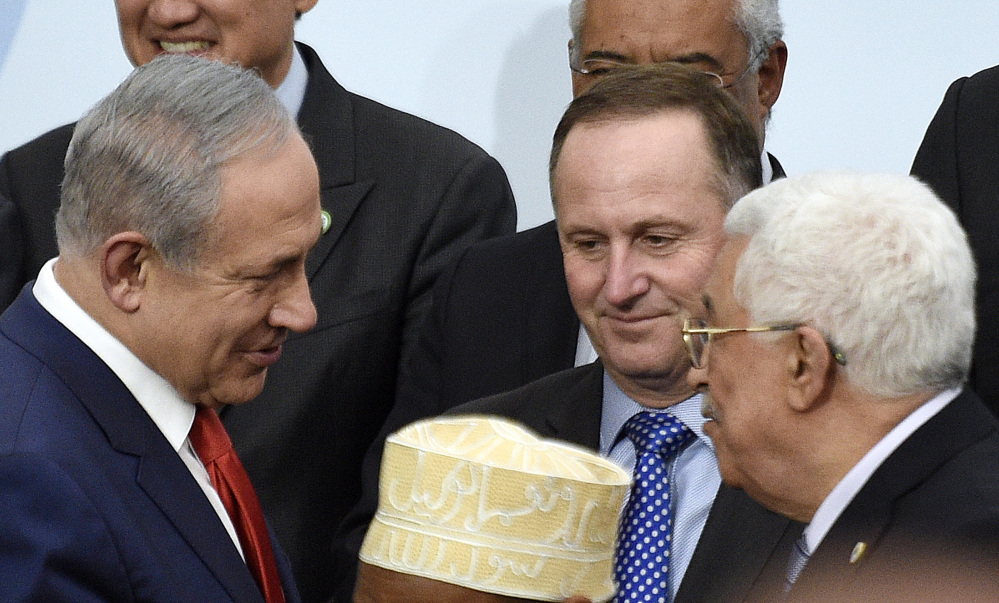 Although Israeli Prime Minister Benjamin Netanyahu, left, and Palestinian President Mahmoud Abbas, right, exchanged handshakes at a climate conference in Paris last year, they have not held a working meeting since 2010.