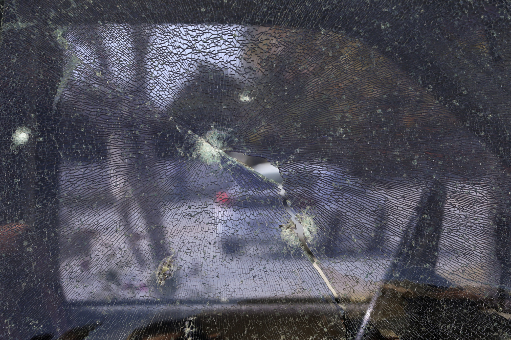Above: The window of a pickup truck is shattered by bullets fired during a police shootout in San Bernardino, Calif., on Dec. 5, 2015, with suspects, in left photo, Syed Farook, right, and his wife, Tashfeen Malik. A new report by the Police Foundation examines the unfolding massacre at a training event and holiday gathering of the San Bernardino County Health Department, where Farook worked.