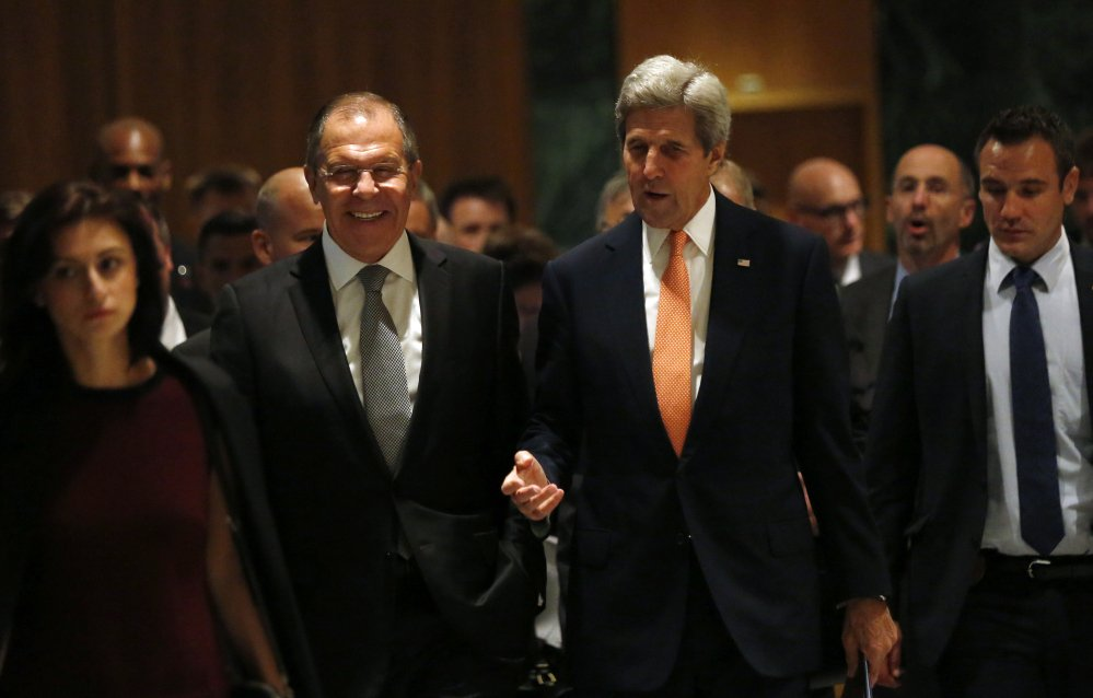U.S. Secretary of State John Kerry, right, and Russian Foreign Minister Sergey Lavrov, walk in to their meeting room in Geneva, Switzerland, Friday to discuss the crisis in Syria.