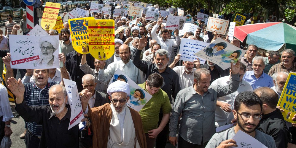 Iranian protesters chant slogans against the ruling Al Saud family of Saudi Arabia, America, Britain and Israel during a rally after weekly Friday prayers in Tehran.