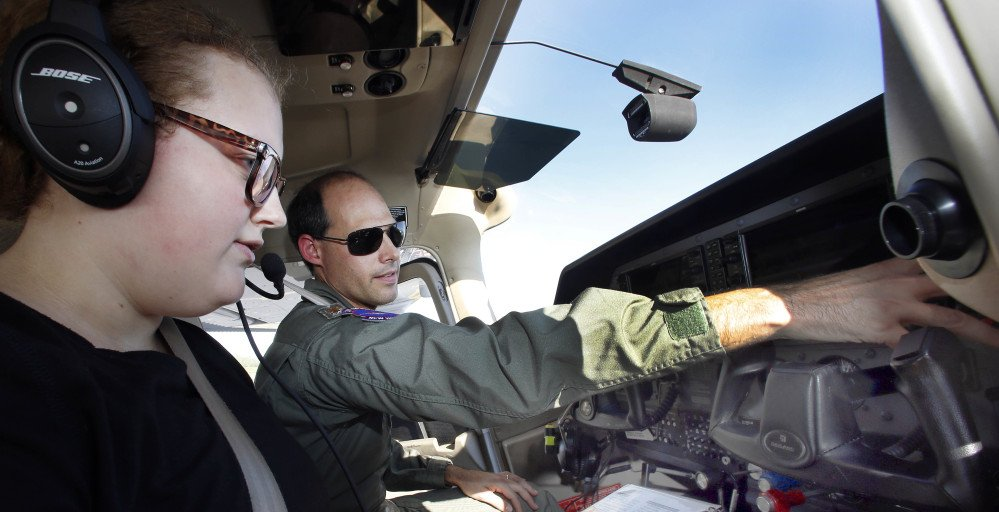 Civil Air Patrol Maj. Rangi Keen goes over preflight procedures with cadet Phoebe Ross at the Mount Washington Regional airport in Whitefield, N.H., on Wednesday. The Civil Air Patrol helps with search-and-rescue efforts and other services.