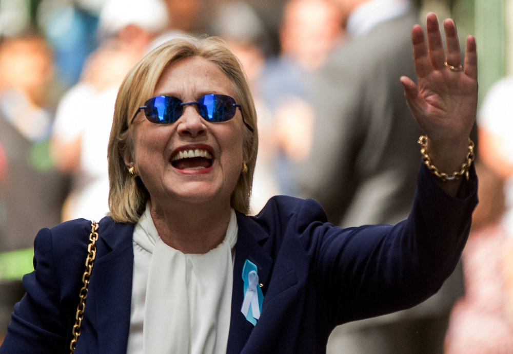 Democratic presidential nominee Hillary Clinton waves after leaving an apartment building Sunday in New York.