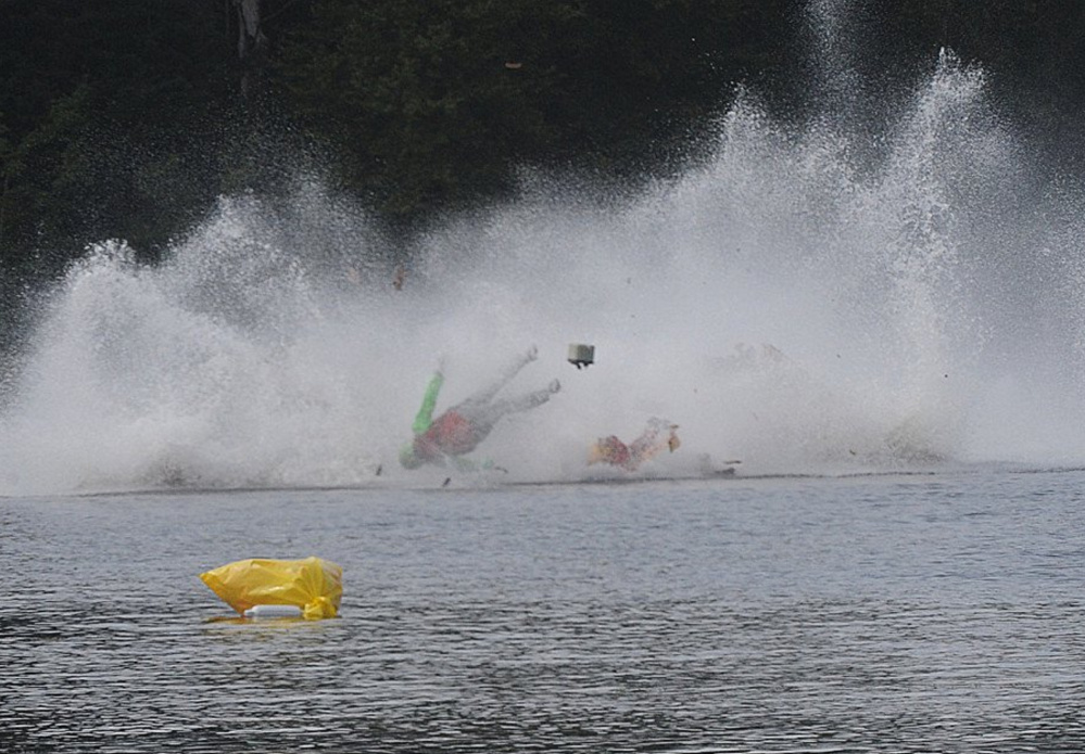A racer goes airborne during a fatal crash Saturday during a regatta in Taunton, Mass., on Saturday.