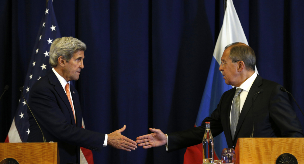 U.S. Secretary of State John Kerry, left, and Russian Foreign Minister Sergei Lavrov are about to shake hands at the conclusion of a joint news conference after their meeting to discuss the crisis in Syria, in Geneva, Switzerland.