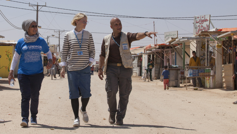 Cate Blanchett, center, and camp manager Hovig Etyemezian, right, walk through the Zaatari camp in Jordan, which houses Syrian refugees. Blanchett and other movie stars address the plight of refugees in a stark, short video.