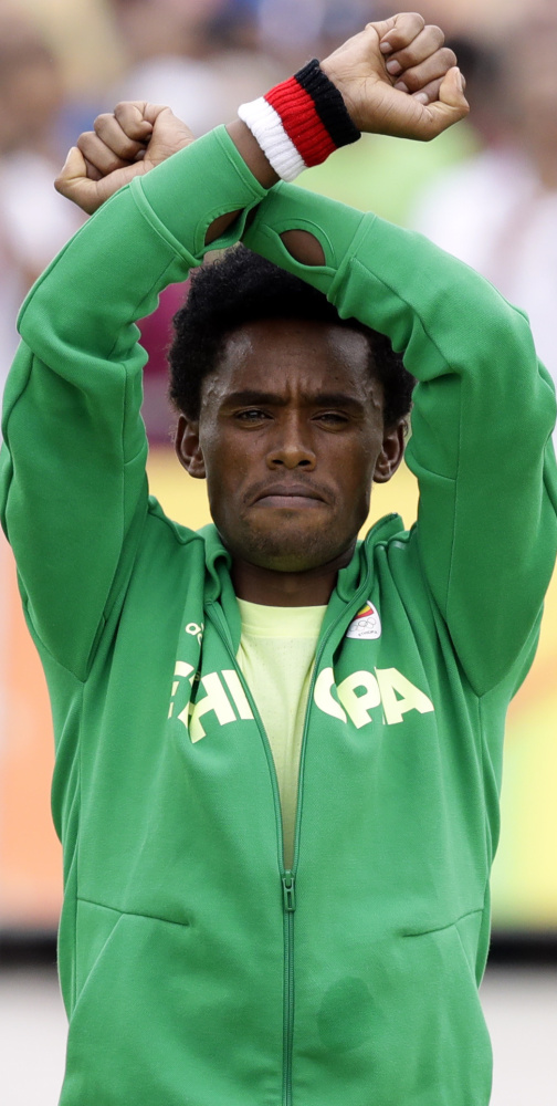 Feyisa Lilesa's efforts to bring international attention to deadly protests in Ethiopia have picked up support, but he is currently living in the U.S. on a special-skills visa because he's afraid to return home.