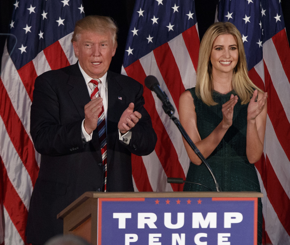 Ivanka Trump applauds as her father, Republican presidential candidate Donald Trump, delivers a policy speech on child care Tuesday in Aston, Pa.