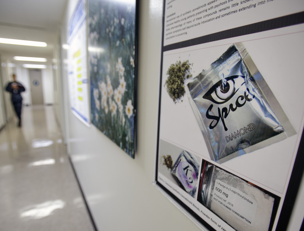 A poster at the Naval Hospital in San Diego warns of the dangers of synthetic drugs like spice, which can escape legal scrutiny if their chemical formulas are tweaked slightly.