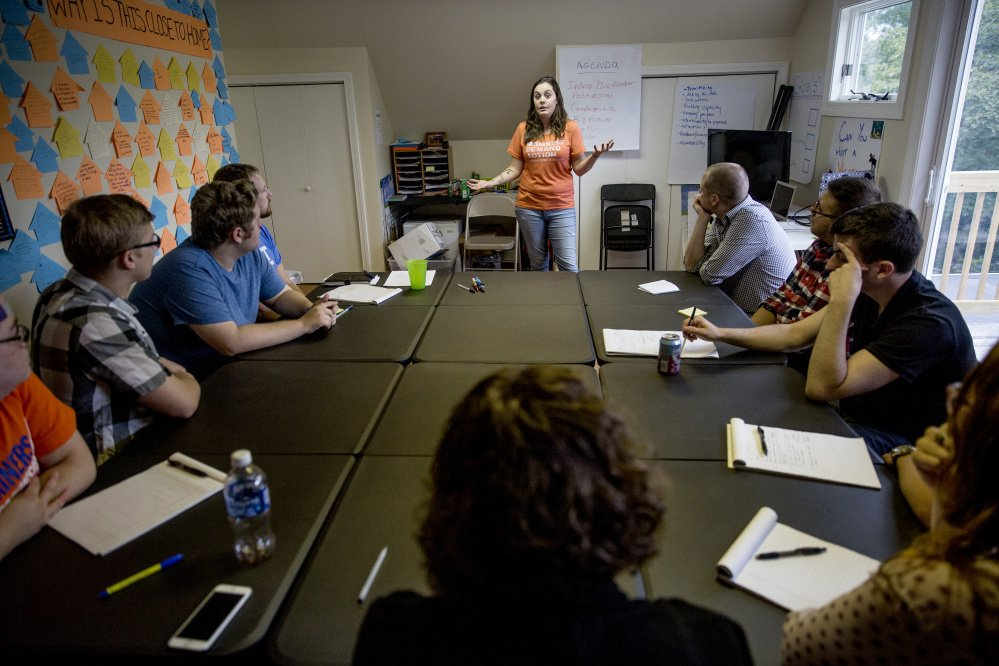 Erica Smegielski, the daughter of the Sandy Hook Elementary School principal who was killed while attempting to confront the shooter, speaks to a group of staff members at the Yes on 3 campaign headquarters in Portland.