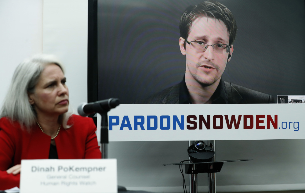 Dinah PoKempner of Human Rights Watch listens as Edward Snowden speaks via video link from Moscow on Wednesday.