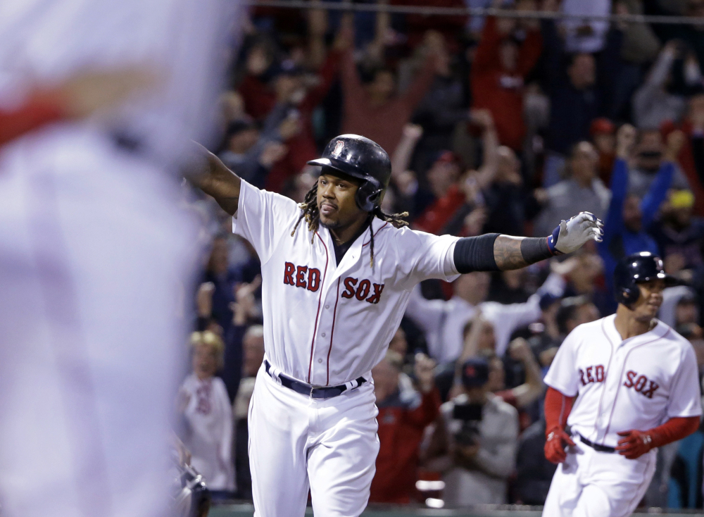 Hanley Ramirez celebrates his three-run walk-off home run in Thursday night's game at Fenway Park. The Red Sox rallied to beat the Yankees, 7-5.