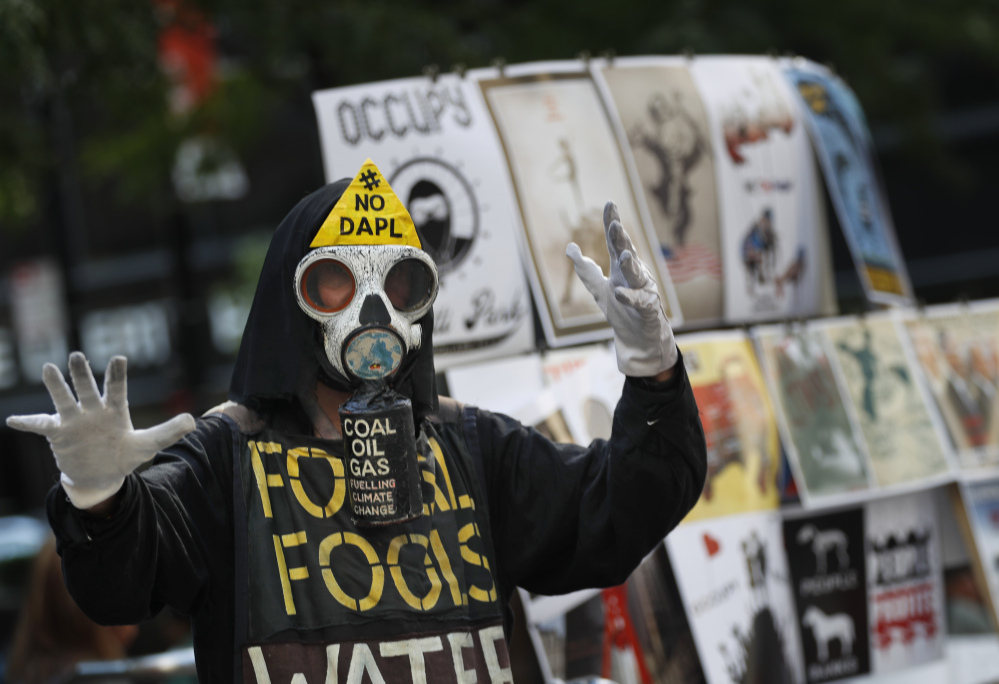 An Occupy Wall Street activist demonstrates on the fifth anniversary of the movement in New York on Saturday, five years after police cleared Zuccotti Park in an overnight raid.