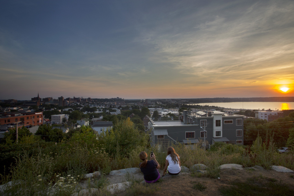 Nicole Hoglund of Portland, left, enjoys the sunset with her niece Sophia Lanzano of New Jersey last month from Fort Sumner Park, a public space on Portland's Munjoy Hill.