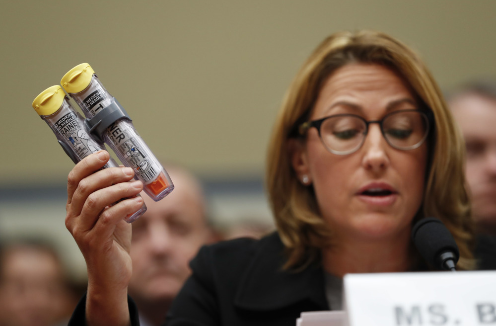 Mylan CEO Heather Bresch holds up an EpiPen while testifying on Capitol Hill in Washington on  before the House Oversight Committee hearing on EpiPen price increases. Bresch defended the cost for life-saving EpiPens, signaling the company has no plans to lower prices despite a public outcry and questions from skeptical lawmakers.