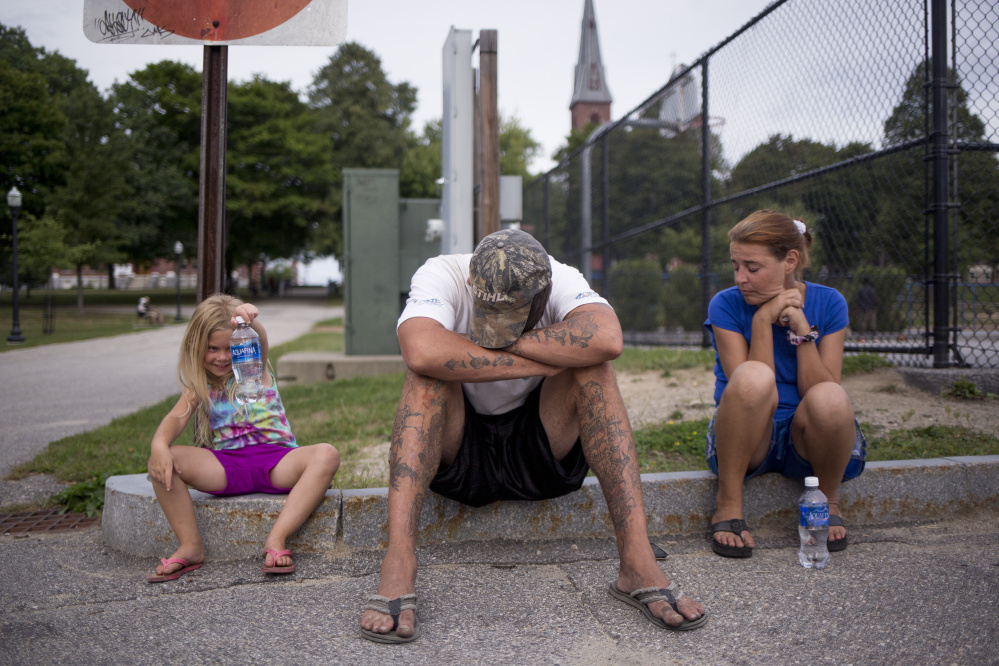 Troy and Chrissy wait in Kennedy Park in Lewiston to hear from the property management company or the landlord. Upon arriving in Lewiston, they found out they had not been approved for an apartment in Auburn and that they might need more references. With the encampment in the woods in Portland no longer an option they had nowhere else to go.