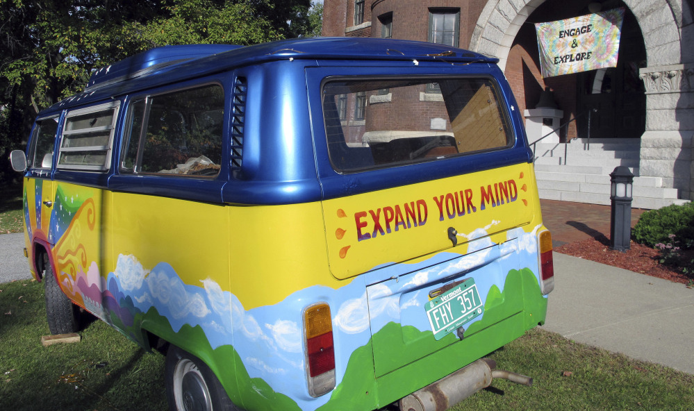 """A vintage Volkswagen van sits outside the Vermont History Center in Barre to promote """"Freaks, Radicals & Hippies,"""" a new exhibit about counterculture in the state during the 1970s."""