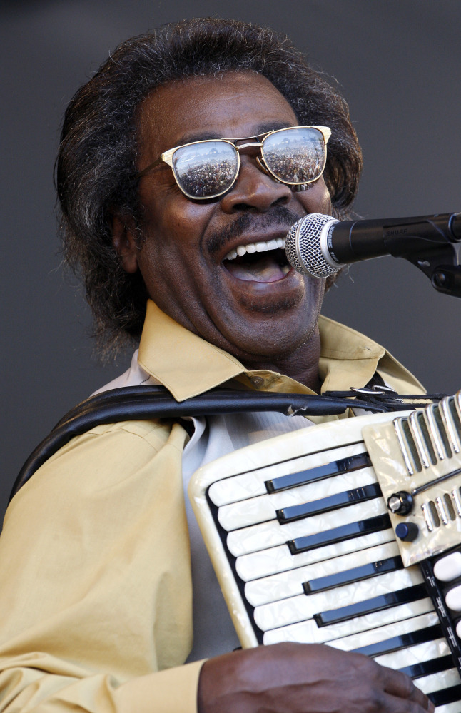 """FILE - In this May 6, 2011 file photo, Buckwheat Zydeco performs at the'New Orleans Jazz and Heritage Festival in New Orleans.  Stanley """"Buckwheat"""" Dural Jr., who introduced zydeco music to the world through his namesake band Buckwheat Zydeco, has died. He was 68. His longtime manager Ted Fox told The Associated Press that Dural died early Saturday, Sept. 24, 2016. He had suffered from lung cancer.(AP Photo/Patrick Semansky)"""