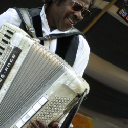 Buckwheat Zydeco performs during the 2007 Jazz and Heritage Festival in New Orleans. His undeniable charisma uplifted audiences.