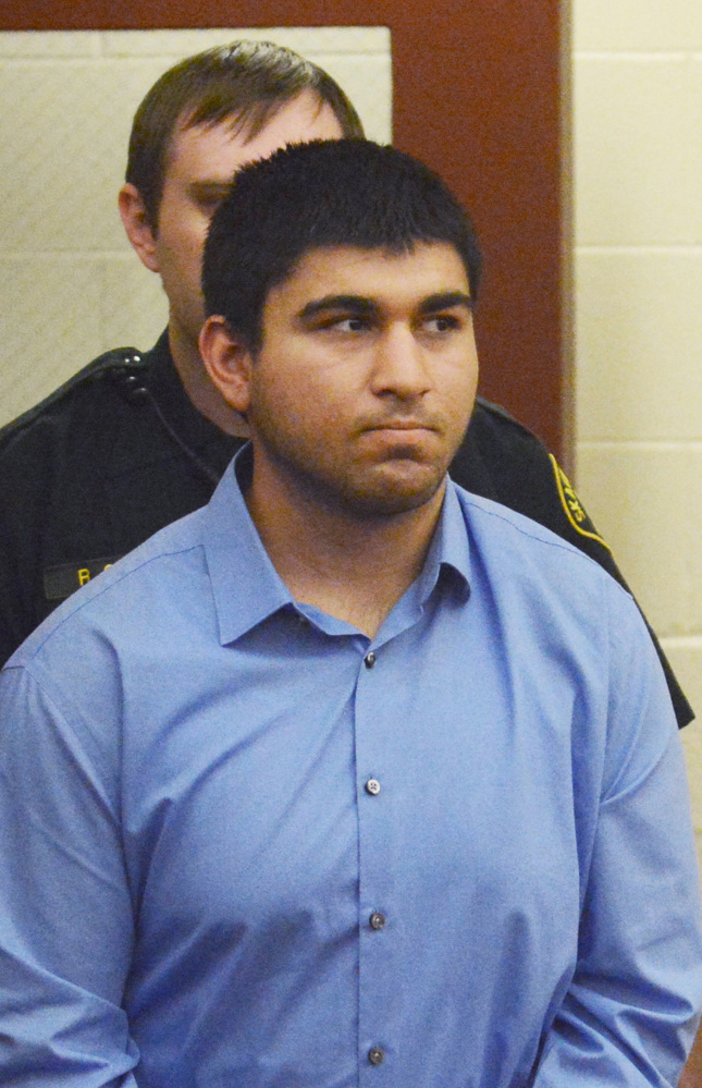 Arcan Cetin is escorted into Skagit County District Court by Skagit County's Sheriff's Deputies on Monday, Sept. 26, 2016. Cetin is being held under a magistrate's warrant which will give Skagit County prosecutors 30 days to file charges in relation to the Cascade Mall shooting that took place on Friday evening. Five people were killed in the shooting, and Cetin is being held on a $2 million bail. (via AP)