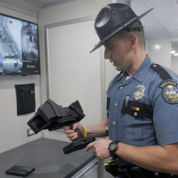Maine State Police Trooper Aaron Turcotte inspects an evidence recorder that is part of the state's new Impaired Driving Roadside Testing Vehicle, which was unveiled at the Maine Bureau of Highway Safety in Augusta. The device records eye movements as evidence for police officers conducting field sobriety tests.