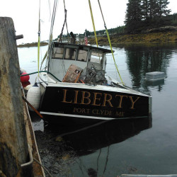 Tony Hooper's lobsterboat is hauled out of the water after it was intentionally sunk on Aug. 17.