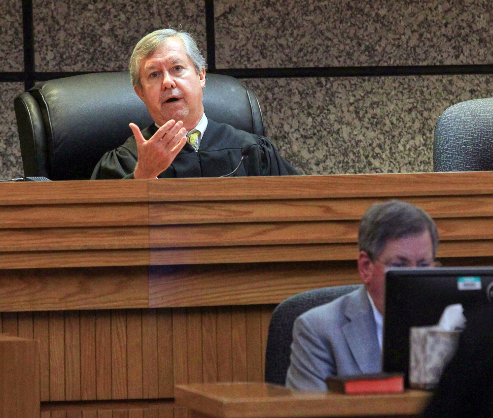 Judge Edgar Long presides over a hearing of a 14-year-old boy who was charged as a juvenile Friday in Anderson, S.C., with murder and three counts of attempted murder after authorities say he killed his father and opened fire on students at a playground, wounding three people.