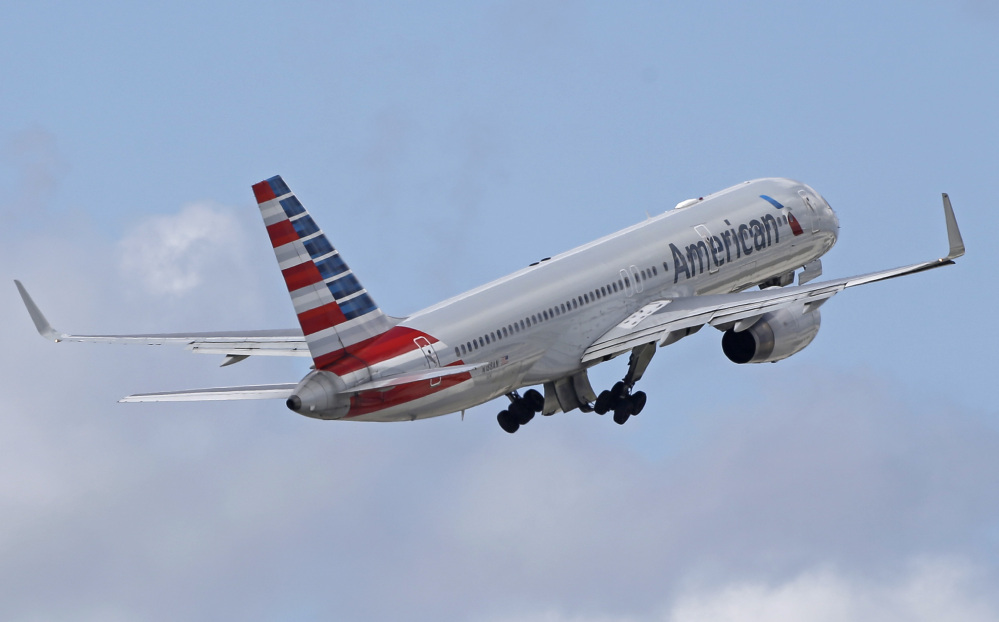 American Airlines chose a light weekend and cut about 200 fights from its schedule before making a flight-operating system change that could have some glitches.