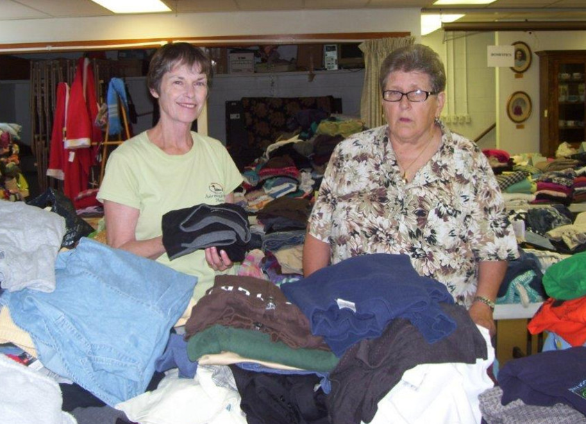 Barbara Rothe and Karin Lyman work to organize gently worn clothing items for the Wayne Community Church Boutique Sale set for 8 a.m. to 1 p.m. Saturday, Sept. 17, and 10:30 a.m.-12:30 p.m. Sunday, Sept. 18.