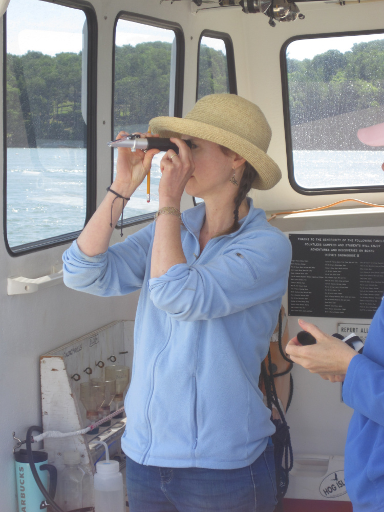 Nicole Danielson, director and science teacher at Maple Tree Community School in Readfield, on the boat during the BLOOM Educators' Program summer workshop she recently attended on exploring oceanography in East Boothbay.