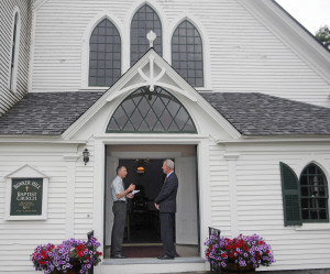 """Mark Johnston, right, and Ed """"Ted"""" Lincoln confer Sunday on the steps of the Bunker Hill Baptist Church in Jefferson. Johnston has played instruments for 50 years at the chapel, where Lincoln serves as moderator."""