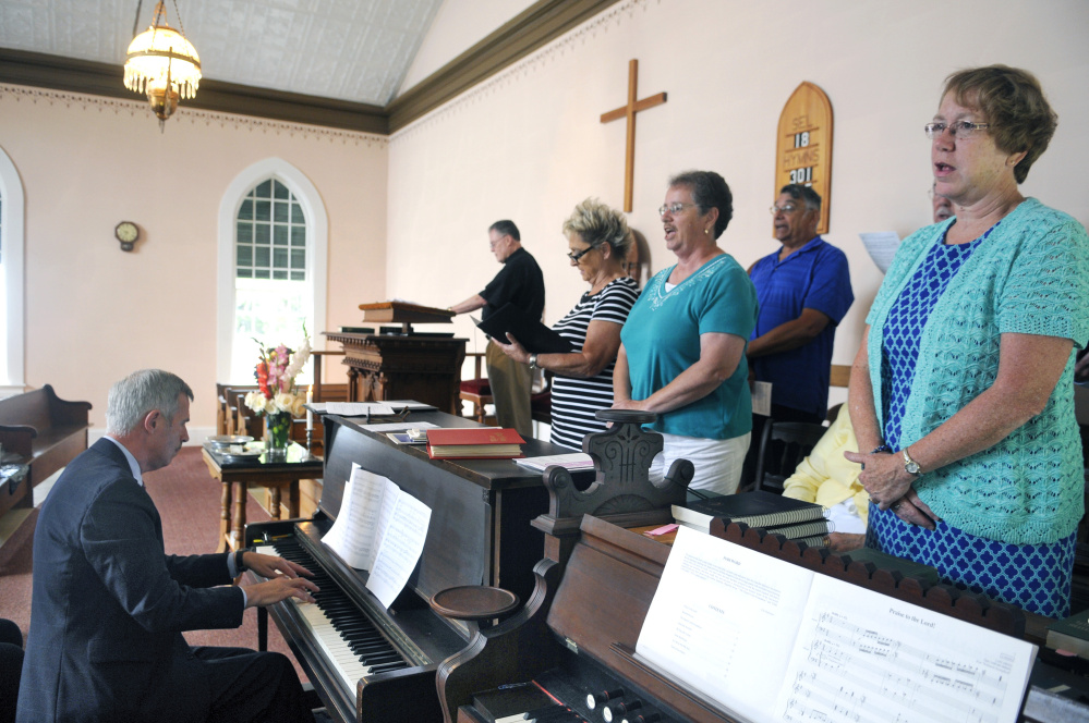 Mark Johnston plays the piano for the chorus during Sunday service at the Bunker Hill Baptist Church in Jefferson. Johnston has played the organ and the piano at the chapel for 50 years.