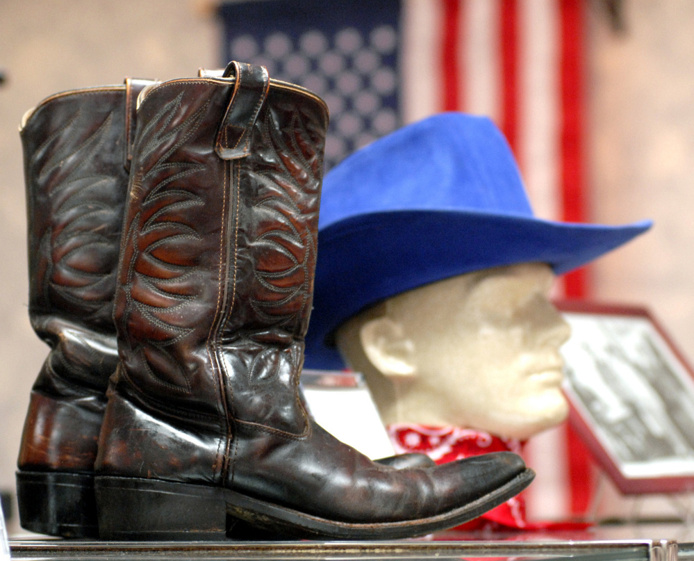 A pair of boots and a hat worn by Bob Elston are seen in 2008 at the Maine Country Music Hall of Fame in Mechanic Falls. Elston, who died in March, was one of the founders of the Maine Country Music Academy in Augusta. The Road Ranger Band, which he founded and which includes his wife, Marlene Carpenter, will perform next week at the Clinton Lions Agricultural Fair.
