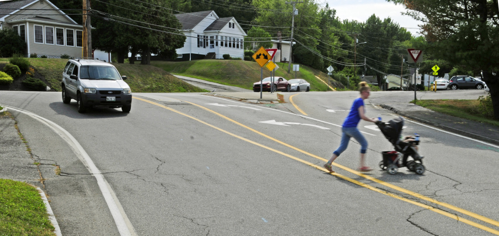 A woman pushes a baby stroller Thursday across Townsend Road near the intersection with Northern Avenue, where a $1.2 million construction project is set to begin this fall.