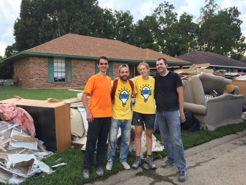 Hall-Dale High School graduate James McCullum, far left, worked recently with other volunteers in Baton Rouge, La., to help the victims of last month's historic flooding that killed 13 and damaged nearly 150,000 homes.