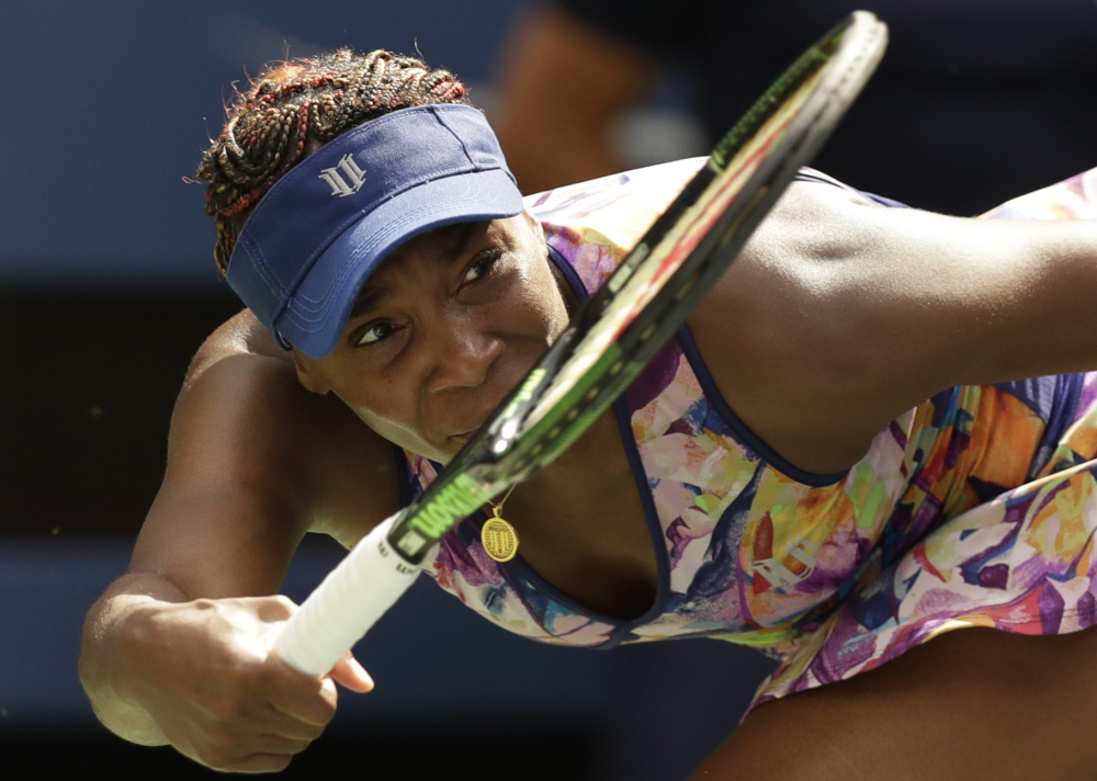 Venus Williams returns a shot to Karolina Pliskova during the fourth round of the U.S. Open on Monday in New York.