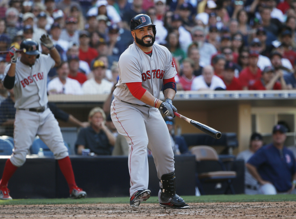 Boston's Sandy Leon reacts after swinging and missing while batting against the San Diego Padres with a runner on third during the eighth inning Monday in San Diego.