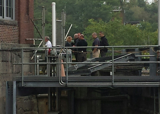 Authorities convene near the Lockwood Dam along the Kennebec River in Waterville Tuesday morning as a body is recovered from the water.