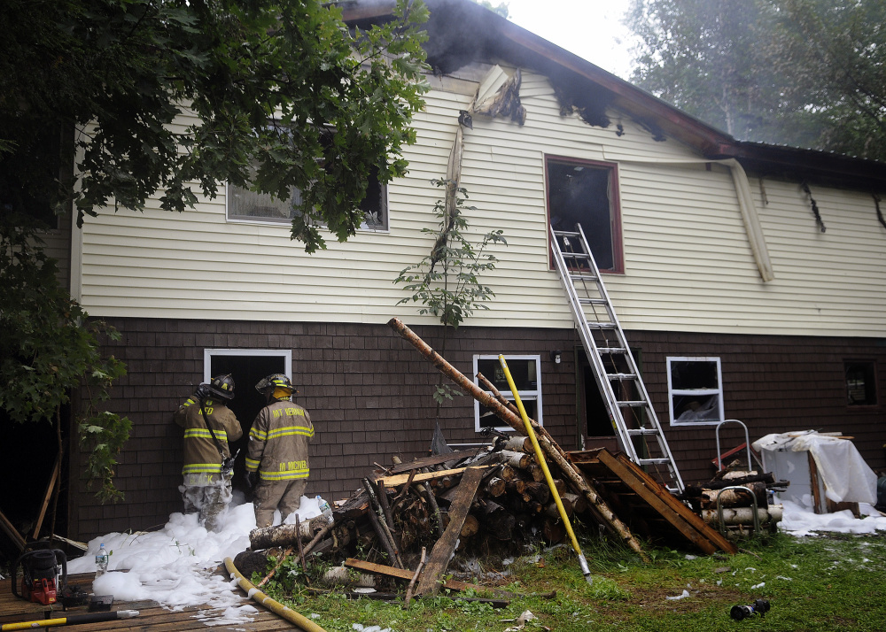 Firefighters extinguish a blaze that heavily damaged a Mount Vernon home early Wednesday morning.