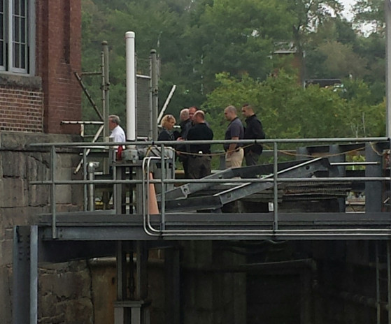 Authorities convene Tuesday morning near the Lockwood Dam along the Kennebec River in Waterville as a body is recovered from the water. Police said Wednesday that the remains were those of Lexxi T. Sironen, a transient who had been living near the river in Waterville.