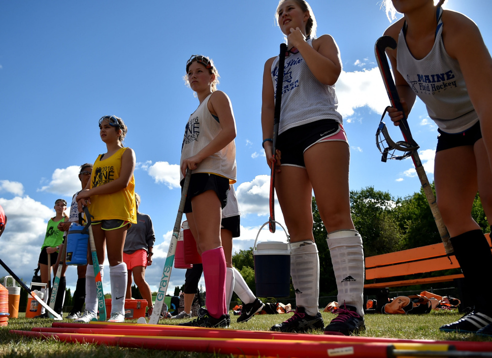 The Winslow High School field hockey team takes a quick break during an Aug. 17 practice at the high school.